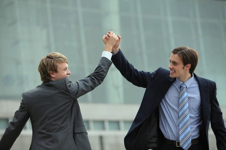 Businessmen clasping hands photo