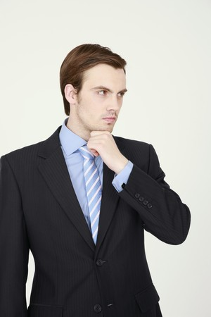 Businessman with hand on chin photo