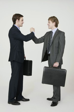 clasping: Businessmen with clasping hands Stock Photo