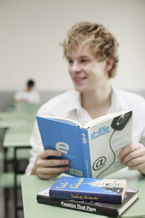 Man reading a book in the classroom Stock Photo - 8227685