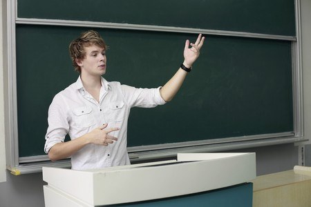 lectern: Man giving presentation from a podium