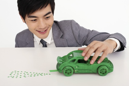 Man playing with toy car photo