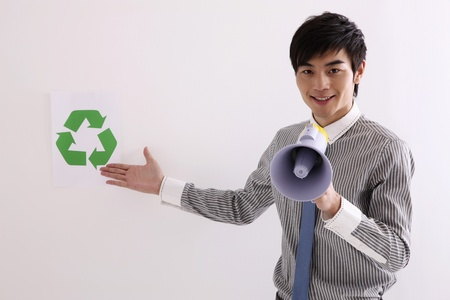 Man with megaphone showing recycling symbol photo
