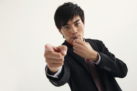 Man blowing whistle and pointing photo