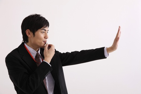 whistle: Man blowing whistle and making a stop gesture Stock Photo