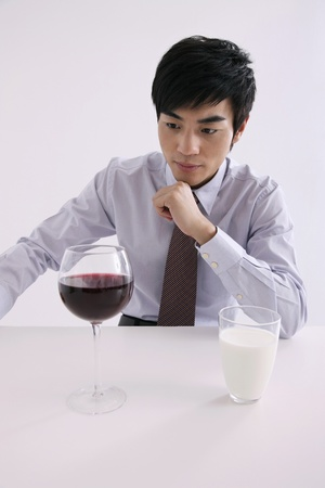 Man looking at wine glass Stock Photo - 8260426