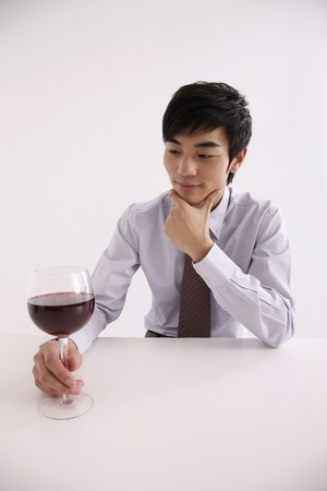 Man holding a glass of wine photo