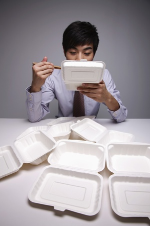 eating out: Man eating take out lunch Stock Photo