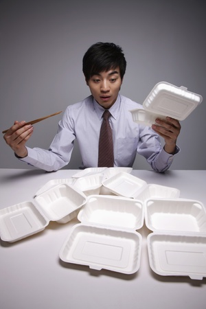 take out: Man having take out lunch