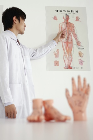 Man pointing at medical diagram Stock Photo