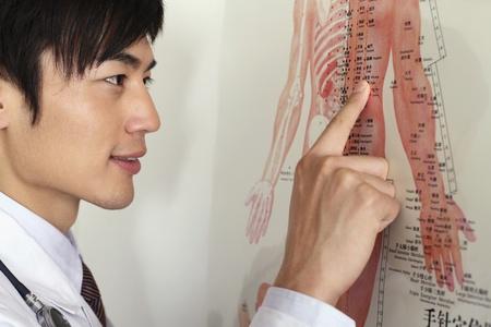 Man pointing at medical diagram photo