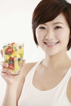 Woman holding a glass of mixed fruits Stock Photo - 8260182