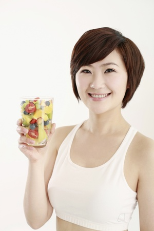 Woman holding a glass of mixed fruits Stock Photo - 8260196