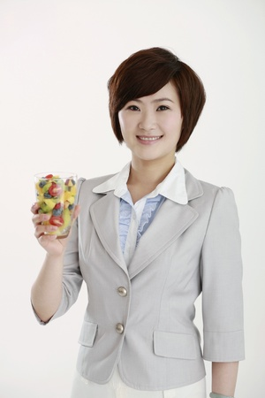Businesswoman holding a glass of mixed fruits Stock Photo - 8260519
