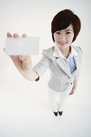 Businesswoman showing her business card Stock Photo - 8260045