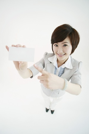 Businesswoman showing her business card Stock Photo - 8259980
