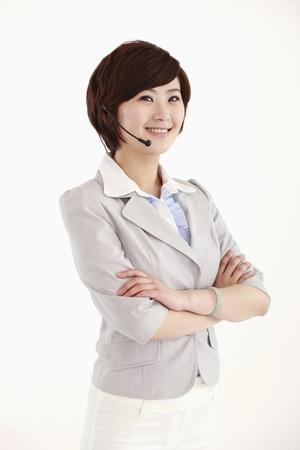 Businesswoman with headset smiling Stock Photo - 8260041