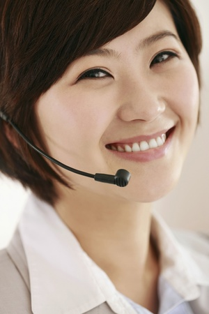 Businesswoman with headset smiling photo