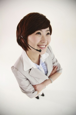 Businesswoman with headset smiling Stock Photo - 8260191
