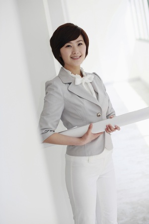 Businesswoman holding blueprint photo