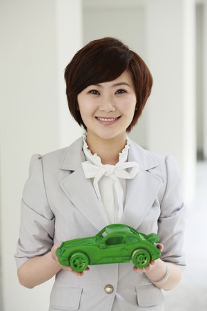car model: Businesswoman holding at wooden car model