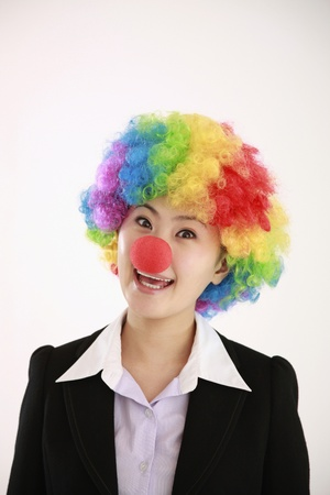 Businesswoman wearing a clown's wig and nose Stock Photo - 8260592