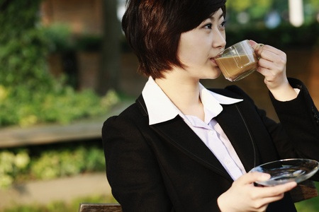 Businesswoman enjoying coffee at an outdoor cafe Stock Photo - 8260224