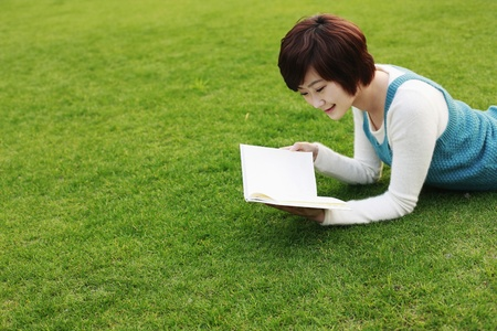 Woman reading outdoors photo