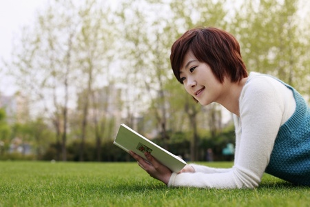 Woman reading outdoors Stock Photo - 8260580