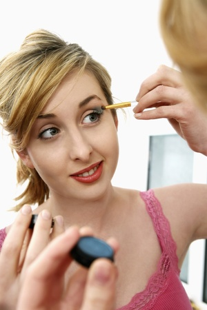 self conceit: Woman applying eyeshadow