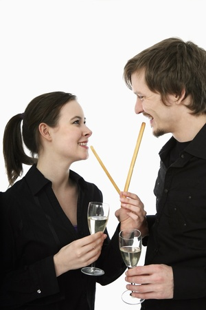 Man and woman with bread sticks photo