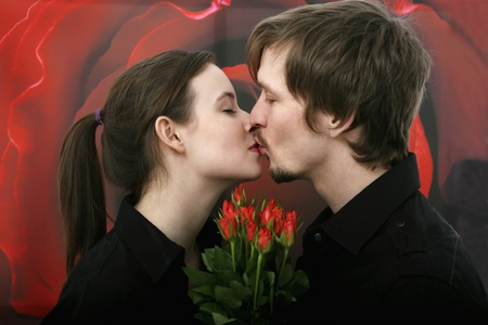 women kissing: Man and woman kissing