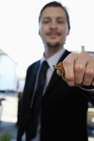 Man holding house key photo