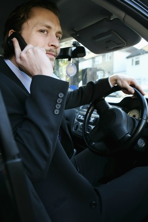 Man talking on the phone in the car photo