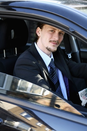 Man smiling while sitting in the car photo