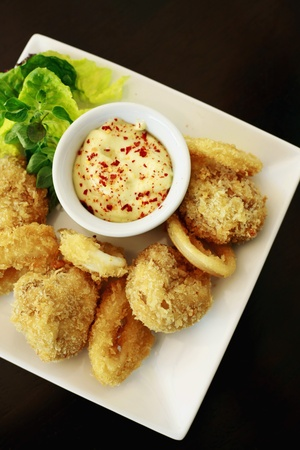 Breaded button mushroom and calamari photo