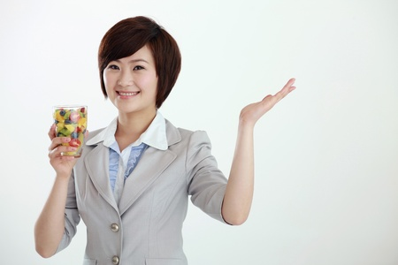 Businesswoman holding a glass of mixed fruits Stock Photo - 8430725