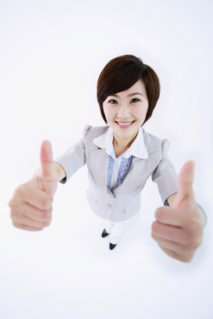 Businesswoman showing double thumbs up