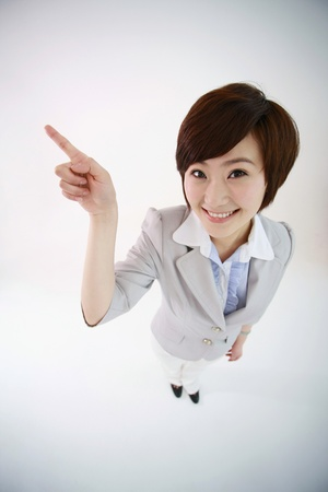 Businesswoman pointing with finger photo