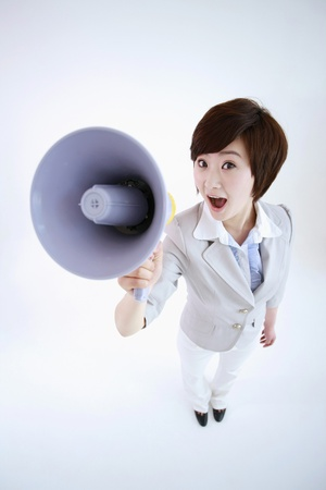 Businesswoman talking into a megaphone Stock Photo - 8430646