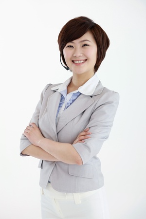 Businesswoman with headset smiling Stock Photo - 8458512