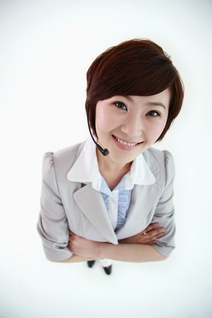 Businesswoman with headset smiling Stock Photo - 8430588