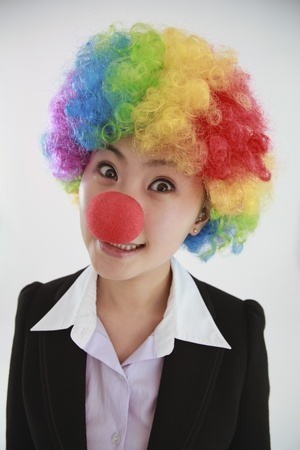 Businesswoman wearing a clowns wig and nose photo
