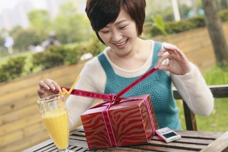 Woman opening her gift photo