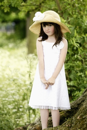 Girl with hat posing for the camera