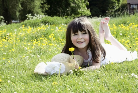 Girl lying in meadow smiling photo