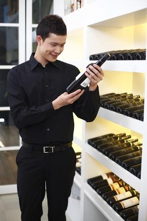 Man choosing wine Stock Photo - 8430615
