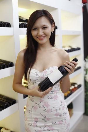 Woman holding a bottle of wine Stock Photo - 8430609
