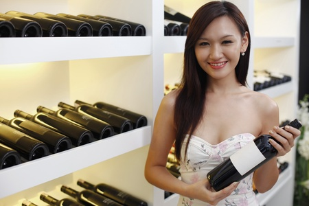 Woman holding a bottle of wine photo