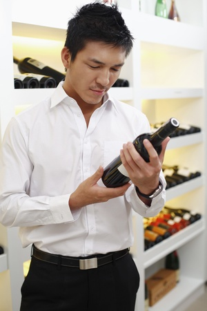 Man choosing wine Stock Photo - 8430611